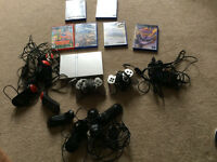Sony Playstation 2 (PS2) with games and controllers