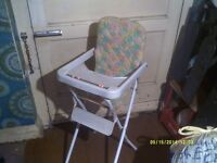 A PERFECT COPY of the REAL THING A PRETTY LITTLE HIGH CHAIR , IT ALL FOLDS UP +++++++