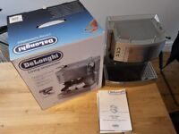 Delonghi Coffee Machine (pod & ground beans) 15 bar pressure, milk frother and cup warmer