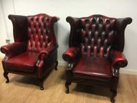 Pair ox blood wing back chesterfield chairs