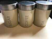 TEA/COFFEE/SUGAR JARS BRAND NEW CREAM SET £8 AND STAINLESS STEEL SET £8. COLLECTION ONLY ,