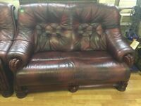 Deep red leather 2 x two seater sofas