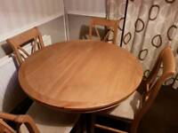 Solid oak dining table with 4 chairs