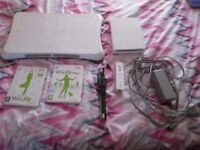 Nintendo Wii White Console bundle complete with power supply,av leads,wii board + games