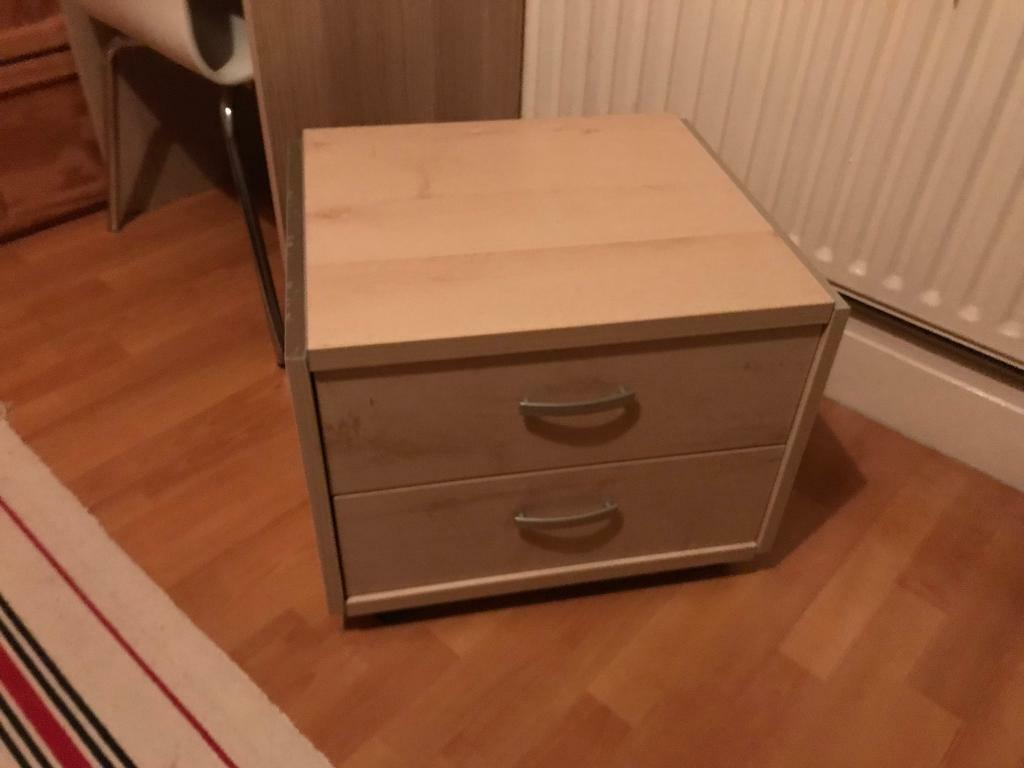 Bedside table with detachable wheels.