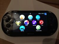 PS Vita with Little Big Planet and Lego Marvel Superheroes
