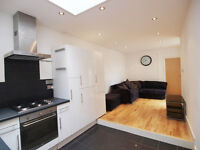 Stunning 3 double bed flat with private patio set between Finsbury Park & Archway stations