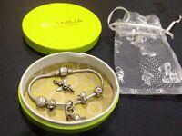 Silver Disney chamilia charm bracelet.