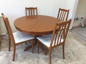 Round extending table and 4 dining chairs by Morris of Glasgow