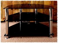 Black Glass & Chrome TV stand - 74cm wide x 55cm high - Good Condition.