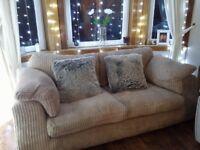 Three seater fabric sofa.
