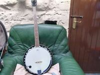 FOR SALE BANJO ozark 5 string left handed banjo complete with electronic tuner and hard case