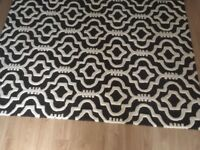 2 rugs 100% wool of Moroccan design in charcoal and ivory