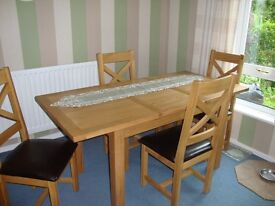 Extendable solid oak dining table and chairs