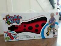 New Boxed Scuttle Bug 3 wheeler ride on (red and black)