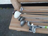 assortment of golf clubs
