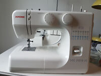 Janome sewing machine w/ cover + accessories