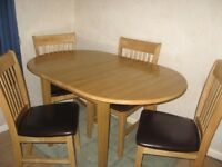 Dining table & four chairs beech wood & faux leather extenable, casual dining Excellent condition
