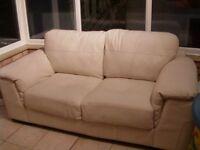White/off white 2 seater leather sofa