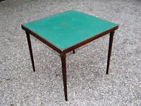 Vono folding card table with green baize top.