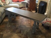 Low coffee table in grey timber with scroll legs