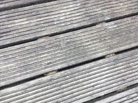 """Approximately 10 m² of wooden decking . 140 mm wide complete with rough sawn 4""""x2"""" Buyer to collecr"""