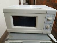 Argos 700 W microwave ***Can deliver***