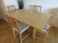 Extendable dining / kitchen table and 4 chairs with seat pads - Good condition - £75 for full set