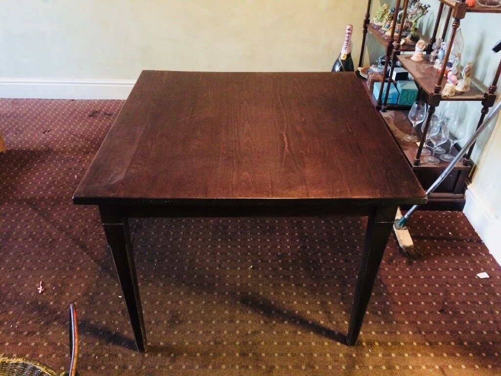 Dark teak square wooden table
