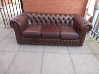 A Brown Leather Chesterfield Three Seater Sofa