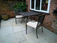 Metal garden table and 4 chairs with cushions