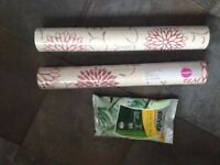Two rolls of wallpaper and bag of wallpaper paste mix. Brand New