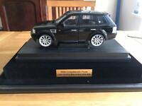 Range Rover Sport model car in display case.