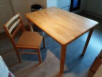 Kitchen Table c/w 3 chairs. Pine Effect.