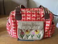 Pink Lining Blooming Gorgeous changing bag red with cream bows