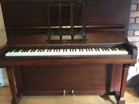 Beautiful mahogany Kemble piano and accompanying piano stool