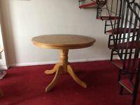 Round-top hardwood dining table £20 LN2