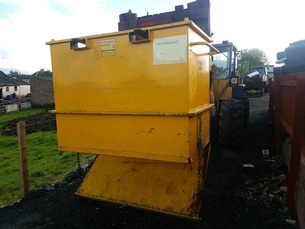 Forklift tipping skip bin floor opens to empty tractor