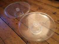 Two simple plastic cake stands