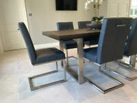 Leather and nickel cantilever dining chairs