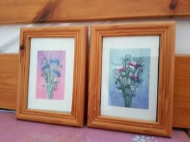 Two small prints and photo frames