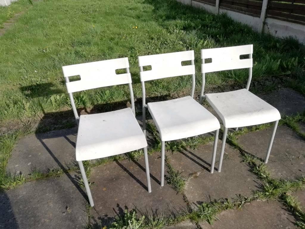 3 white plastic chairs FREE!