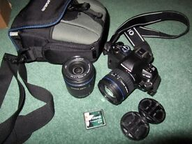 Olympus E-420 with bag and additional zoom lense.
