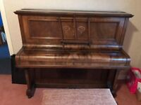 Beautiful upright piano for sale.
