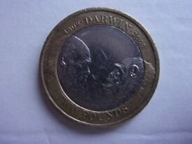 2009 DARWIN WITH APE. £2.00. COIN. THE COIN AS BEEN IN CIRCULATION.