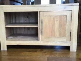 Light oak media cabinet.