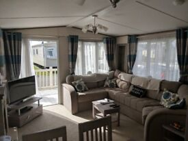 Caravan with decking for sale on 12 month park