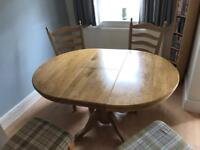 Oak table and 6 chairs open to offers