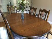 Dining Room table (fully extendable) and 6 Chairs in excellent condition.