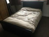 Double bed, black leather.